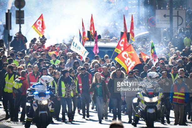 Yellow vest protestors and union members march during a 'day of strike' called by France's CGT union in the southern French city of Marseille on...