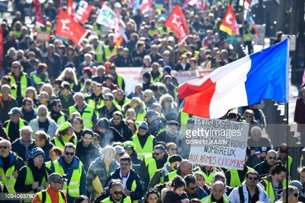 TOPSHOT Yellow vest protestors and union members march during a 'day of strike' called by France's CGT union in the southern French city of Marseille...