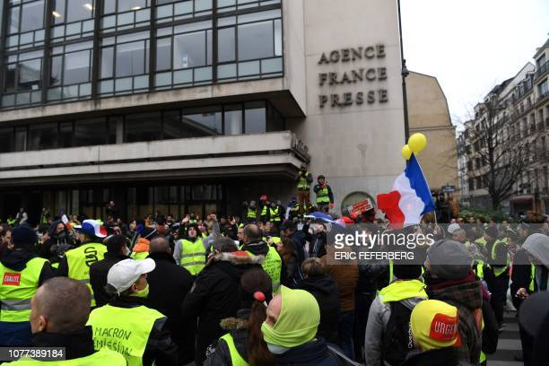 Yellow vest protestors gather outside Agence FrancePresse headquarters in Paris on January 5 during a rally by yellow vest Gilets Jaunes...