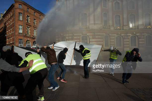 Yellow Vest protetsert stand in front a police water cannon with a banner Act XIII dubbed 'Civil disobediencequot' of the Yellow Vest movement begun...
