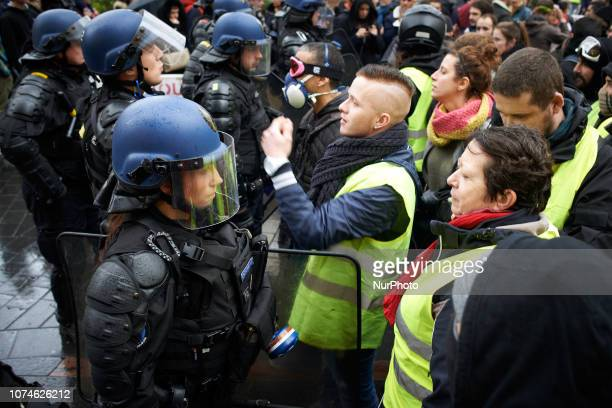 Yellow Vest try to argue with Gendarmes Mobiles Act VI dubbed 'Revolt' of the Yellow Vest movement begun peacefully but the protest turned rapidly to...