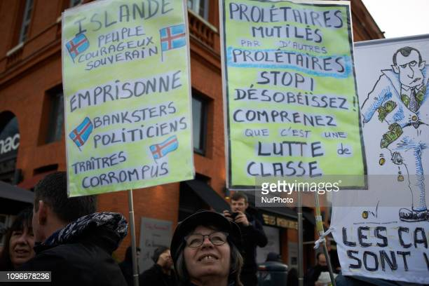 A Yellow Vest woamn holds placards against police and Macron's policies Act XIII dubbed 'Civil disobediencequot' of the Yellow Vest movement begun...