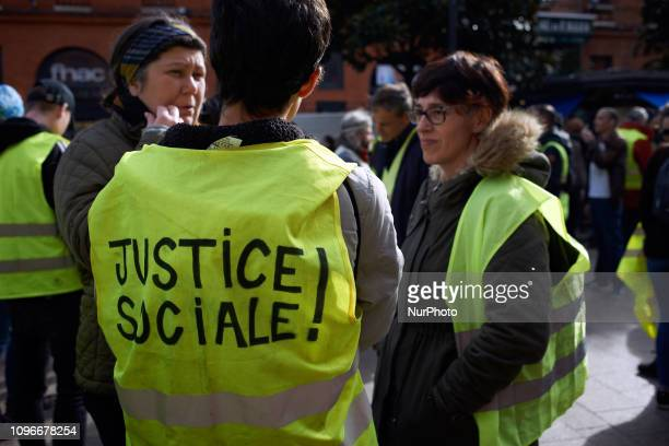 A Yellow Vest woman has written on her back 'Social justice' Act XIII dubbed 'Civil disobediencequot' of the Yellow Vest movement begun peacefully...