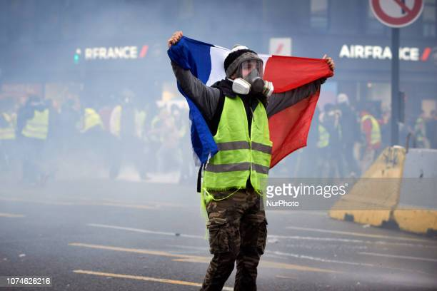 A Yellow Vest wrapped in a French Flag confronts riot police and water cannons Act VI dubbed 'Revolt' of the Yellow Vest movement begun peacefully...