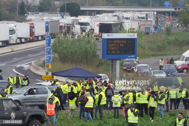 Yellow Vests block the road as they demonstrate against the rising of the fuel and oil prices on November 19 2018 on the A9 highway toll near...