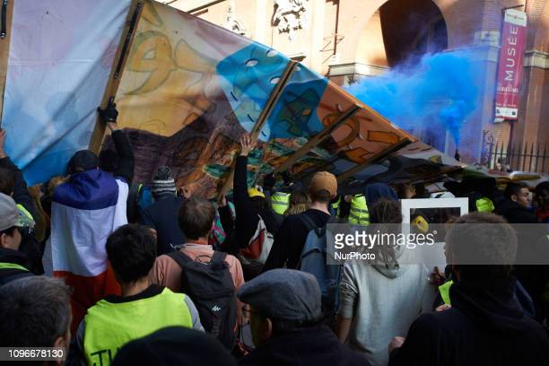Yellow Vests hold up a banner near a blue smoke Act XIII dubbed 'Civil disobediencequot' of the Yellow Vest movement begun peacefully but the protest...