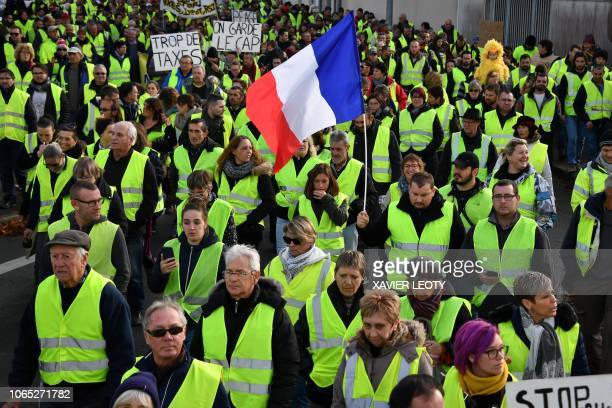 TOPSHOT Yellow Vests participate in a protest rally against high fuel prices in Rochefort southwestern France on November 24 part of a movement which...