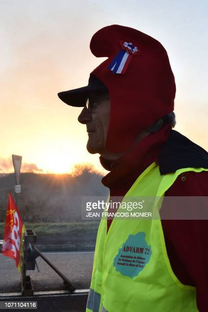 A 'Yellow vests' protester wears a Phrygian cap during a rally to block the access to the 'Carrefour Supply Chain' the regional logistics centre of...