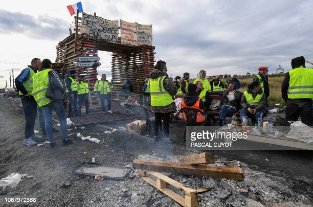 Yellow vests protesters block the road leading to the Frontignan oil depot in the south of France as they demonstrate against the rise in fuel prices...
