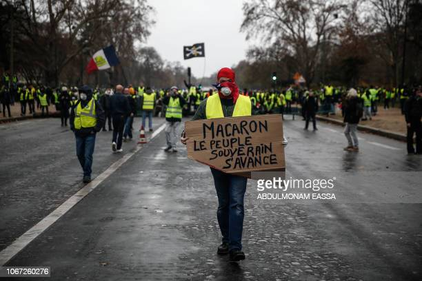 TOPSHOT Yellow vests protesters demonstrate against rising oil prices and living costs on December 1 2018 in Paris