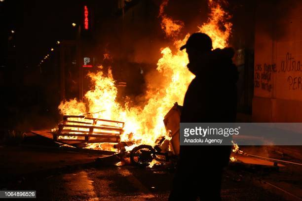 Yellow vests protestors burn barricades to block streets during a protest against rising oil prices on the Champs Elysees in Paris France on November...