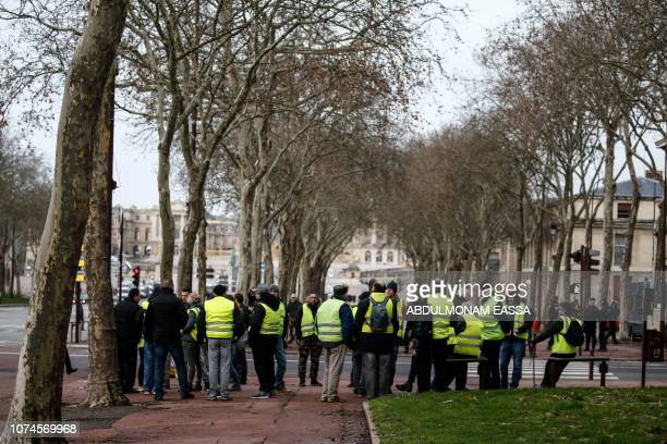 'Yellow Vests' protestors gather to demonstrate in front of the Chateau de Versailles in Versailles outside Paris on December 22 2018 The 'Yellow...