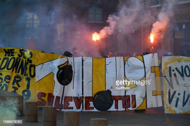 Yellow Vets protesters stand amid clouds of tear gas with their banners Act XIII dubbed 'Civil disobediencequot' of the Yellow Vest movement begun...
