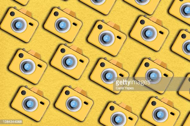 yellow vintage  camera pattern - webcam media apparaat stock pictures, royalty-free photos & images