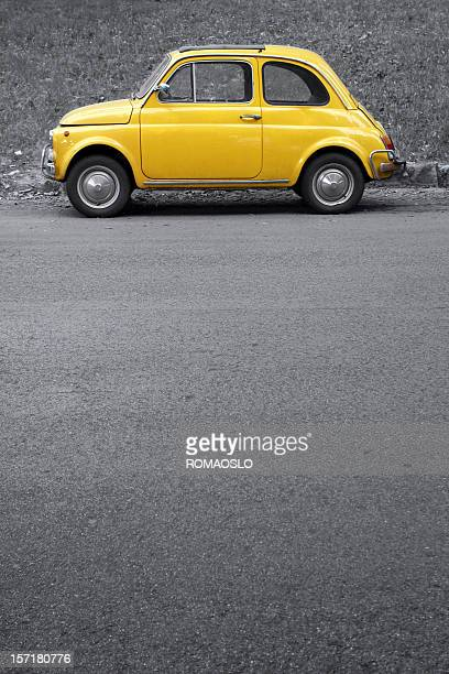 Yellow vintage car on grey,Rome Italy