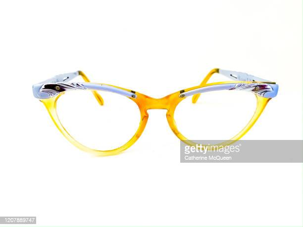 yellow vintage silver-rimmed cat eye glasses - cat's eye glasses stock pictures, royalty-free photos & images