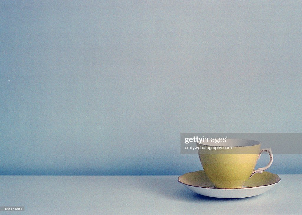 yellow vintage teacup : Stock Photo