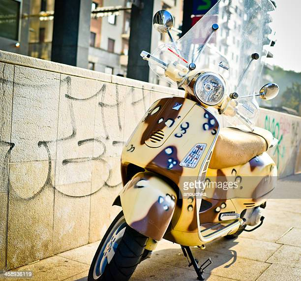 yellow vintage vespa scooter parked on milan street - vespa brand name stock pictures, royalty-free photos & images