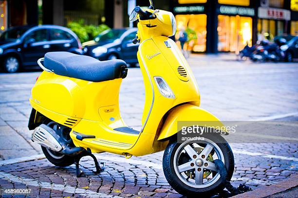 Yellow Vintage Vespa Scooter parked on Milan Street
