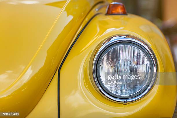 yellow volkswagen beetle - beetle stock pictures, royalty-free photos & images