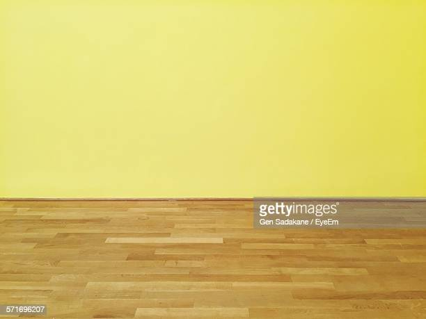 Yellow Wall And Parquet Floor