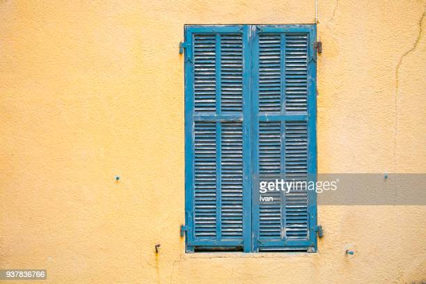 yellow wall with blue window - shutter stock pictures, royalty-free photos & images