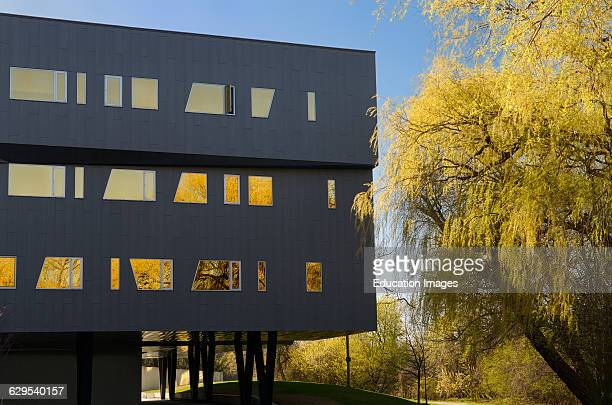Yellow willow trees and the futuristic architecture of the Perimeter Institute building in Waterloo Canada