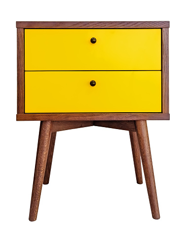 Yellow wood bedside table. Modern designer nightstand isolated on white background front view. cabinet with two drawers 1126450178