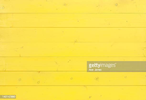 yellow wooden background - yellow stock pictures, royalty-free photos & images