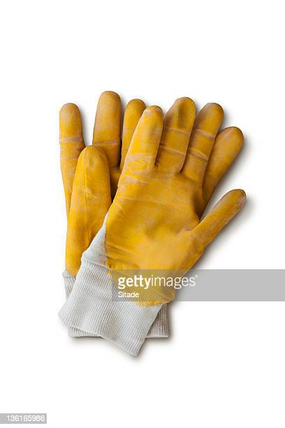 yellow work gloves with clipping path - work glove stock photos and pictures