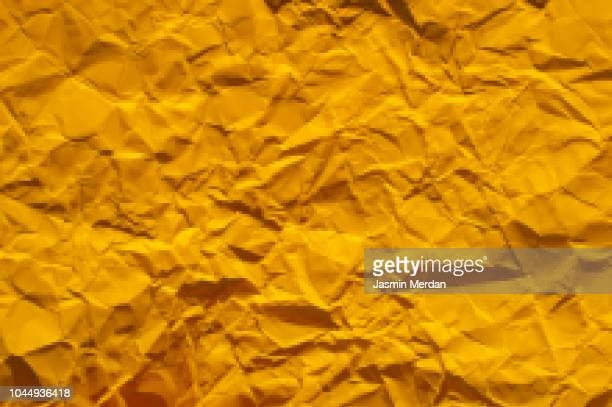 yellow wrinkly paper background - pixelated - crushed leaves stock pictures, royalty-free photos & images
