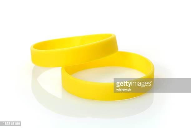 yellow wristband - rubber stock pictures, royalty-free photos & images