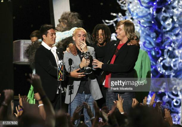 Yellowcard accept the MTV2 Award at the 2004 MTV Video Music Awards at the American Airlines Arena on August 29 2004 in Miami Florida