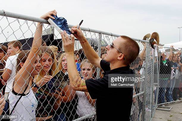 Yellowcard's Ryan Key signs autographs for fans at the 2004 Vans Warped Tour at the Tweeter Center July 25 2004 in Chicago