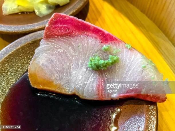 yellowtail sashimi slice w/ wasabi, dipping soy sauce - sashimi stock pictures, royalty-free photos & images