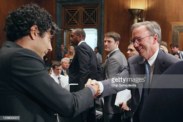 Yelp cofounder and CEO Jeremy Stoppelman shakes hands with Google Executive Chairman Eric Schmidt after he testified before the Senate Judiciary...