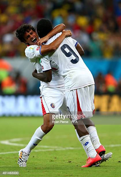 Yeltsin Tejeda and Joel Campbell of Costa Rica celebrate the win after the penalt shootout in the 2014 FIFA World Cup Brazil Round of 16 match...
