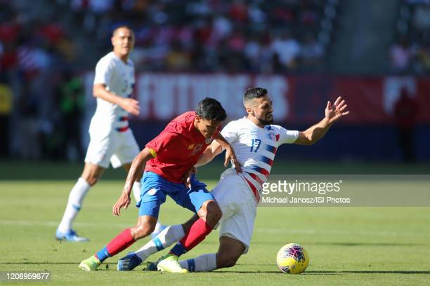 Yeltsin Tejeda of Costa Rica and Sebastian Lletget of the United States collide during a game between Costa Rica and USMNT at Dignity Health Sports...
