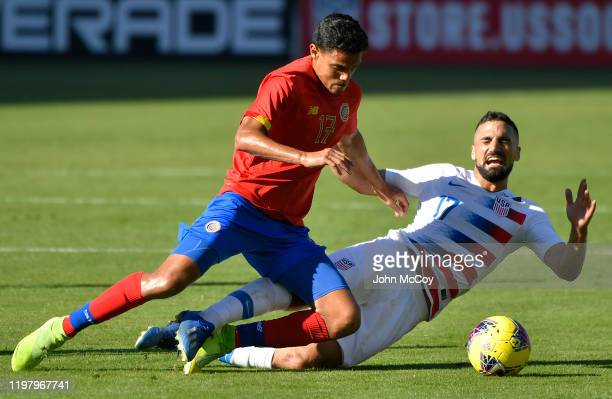 Yeltsin Tejeda of Costa Rica and Sebastian Lletget of the United States battle for the ball at Dignity Health Sports Park on February 1 2020 in...