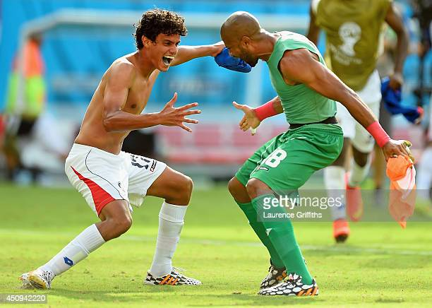 Yeltsin Tejeda of Costa Rica celebrates with teammate Patrick Pemberton after defeating Italy 1-0 during the 2014 FIFA World Cup Brazil Group D match...