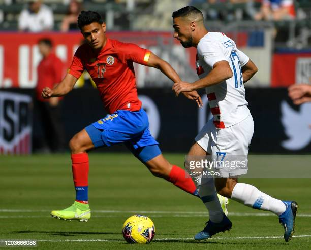Yeltsin Tejeda of Costa Rica fights for the ball with Sebastian Lletget of the United States at Dignity Health Sports Park on February 1 2020 in...