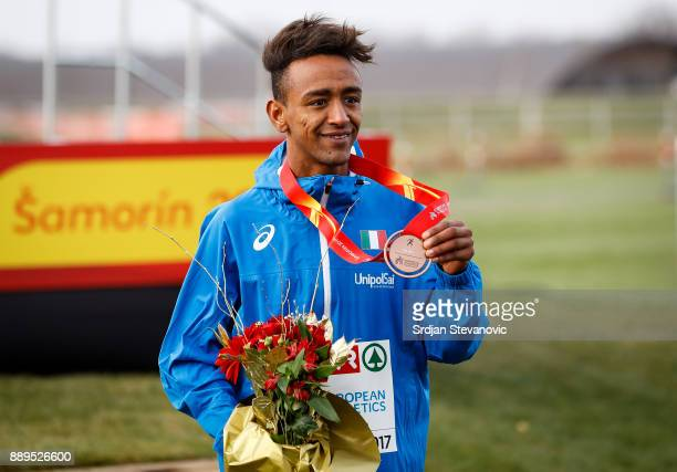 Yemaneberhan Crippa of Italy celebrates his Bronze Medal during the U23 Men's award ceremony during the SPAR European Cross Country Championships on...