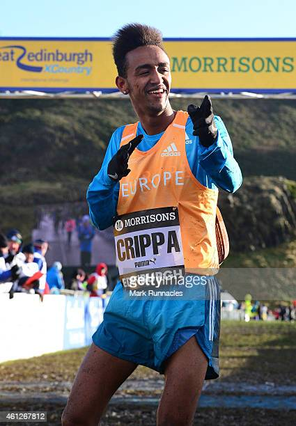 Yemaneberhan Crippa of Team Europe celebrates winning the Junior Men's 6k race during the Great Edinburgh X Country at Holyrood Park on January 10...