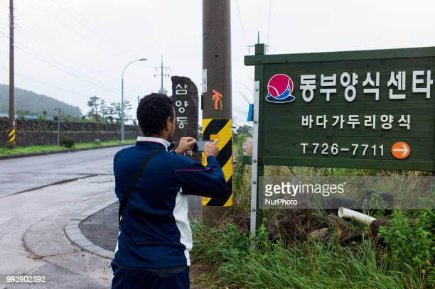 Yemen refugee Bakil takes pictures of the road signs at Jeju city in Jeju Island South Korea on July 08 2018 All Yemeni refugees cant read Hangul so...