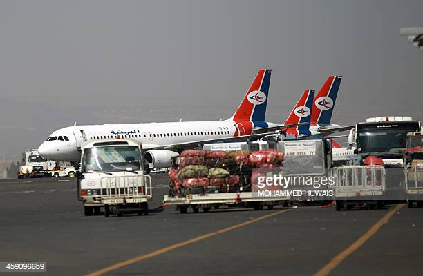 Yemeni Airways planes are seen parked in the tarmac at Sanaa International Airport after the airport was reopened following a strike on December 23...