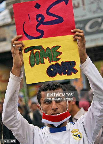 A Yemeni antigovernment protester holds up a placard during a protest against President Ali Abdullah Saleh in Sanaa on March 19 a day after some 52...