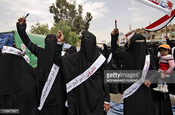 Yemeni antigovernment protesters chant slogans against President Ali Abdullah Saleh during a demonstration in Sanaa on March 19 a day after some 52...