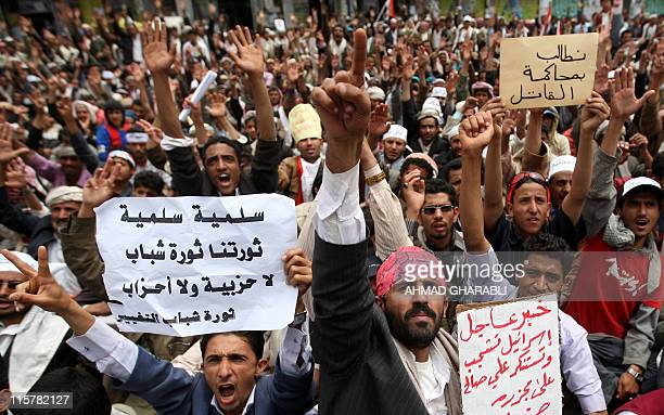 Yemeni antigovernment protesters chant slogans against President Ali Abdullah Saleh during a demonstration in Sanaa on March 19 2011 as medics raised...