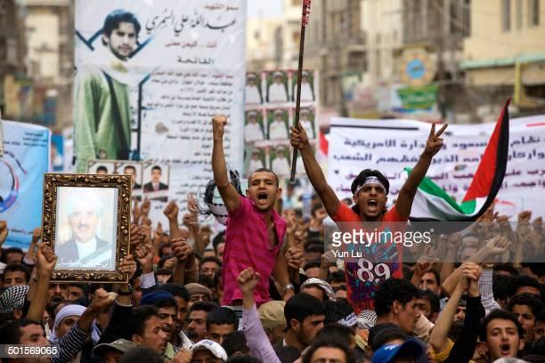 Yemeni anti-government protesters chant slogans during a demonstration demanding the ouster of Yemeni President Ali Abdullah Saleh in Sanaa on June...