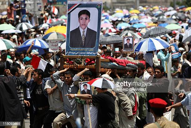 Yemeni antiregime mourners carry the body of a fighters loyal to opposition tribal chief Sheikh Sadiq alAhmar during a mass funeral in Sanaa after...